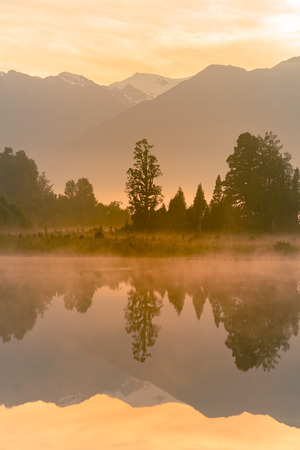Mirror water lake early morning, Matheson lake New Zealand natural landscape Stock Photo