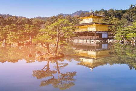 Kinkakuji pavilion golden temple with reflection on water lake, Japan historic landmark