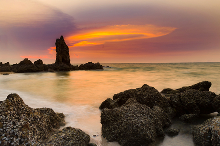 Sea rock beach with after sunset sky background Stock Photo