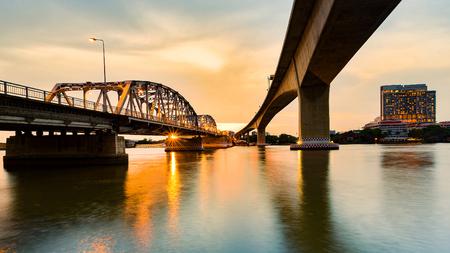 Sunset over river under bridge, natural landscape background 写真素材