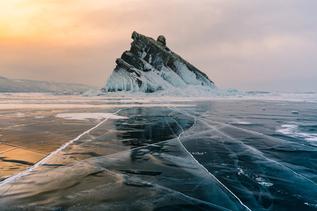 Breaking crack Ice over Baikal water lake Russia winter season natural landscape background