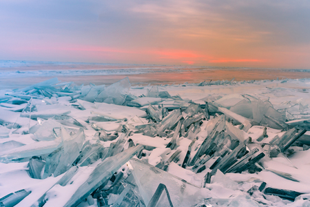 Breaking water lake surface with sunrise sky background, Baikal winter season natural landscape Russia