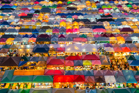 Multiple colour rooftop night market, cityscape downtown background Stock Photo