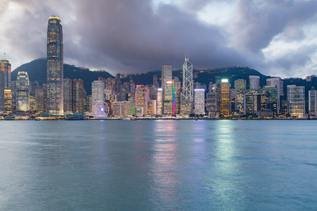 Night light Hong Kong central business downtown sea front, cityscape background