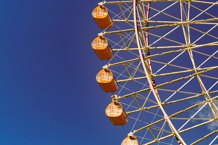 Path of giant ferris wheel against clear blue sky background