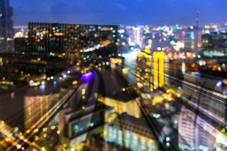 Night blur bokeh light city central business over train track moving, abstract background Stockfoto
