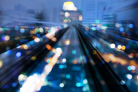Blue blur light city downtown over motion train track, abstract background Stockfoto