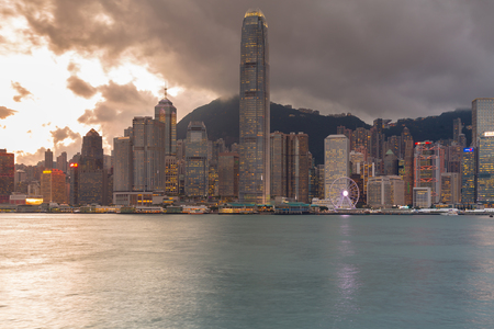 Hong Kong central business building sea front after sunset Stockfoto