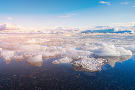 Jokulsarlon ice lagoon with blue sky, Iceland winter season natural landscape background