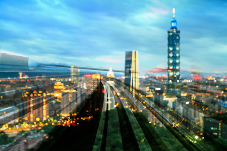 Train track over Taipie blur light cityscape downtown, abstract background Stockfoto