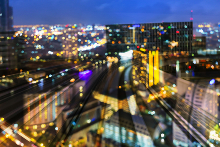 City light blur bokeh aerial view over train track curved, abstract background