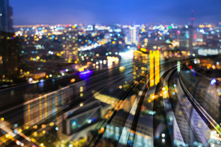 Night blur light city bokeh over train track motion curved, abstract background