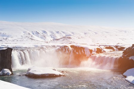 Godafross waterfall with clear blue sky background, Iceland winter season natural landscape