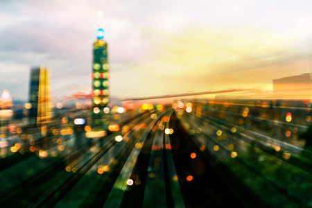 Night blur light taipei city downtown over train track, abstract background