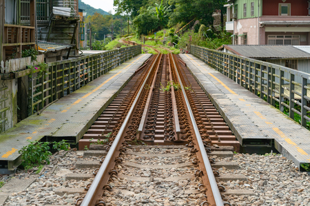 Train track over bridge leading to local city, transportation background