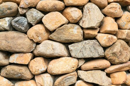 Rock wall outdoor decorated, background and texture Imagens