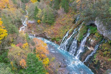 Shirahige Waterfall during autumn season, Hokkaido Japan natural landscape background Standard-Bild - 140083065
