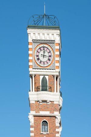 Clock Tower close up with blue sky background Standard-Bild - 140083066
