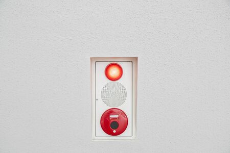 Fire alarm light and sound on white cement wall
