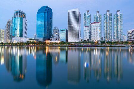 Twilight city office building reflection over water lake, cityscape background Reklamní fotografie