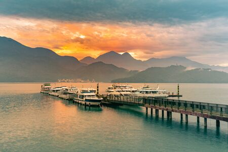 Sun Moon Lake with port and sunrise mountain background, Taiwan natural landscape background