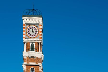 Clock Tower close up with blue sky background