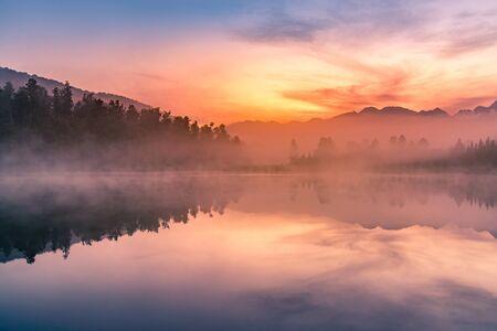 Matheson lake with reflection with beauty sunrise sky  background, New Zealand natural landscape background