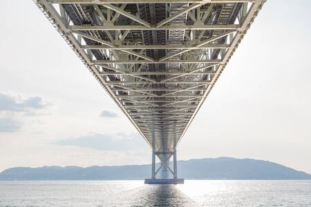 Under stell bridge construction over sea coast, Akashi Kaikyo suspension bridge, Kobe Japan