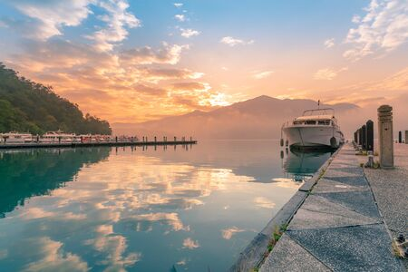 Sun Moon Lake reflection water lake with tour jetty during sunrise, Taiwan natural landscape Archivio Fotografico