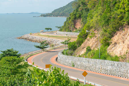 Road curved on coastline with sea coast skyline