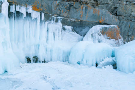 Frost ice on black rock cave, Russia winter season natural landscape background 스톡 콘텐츠