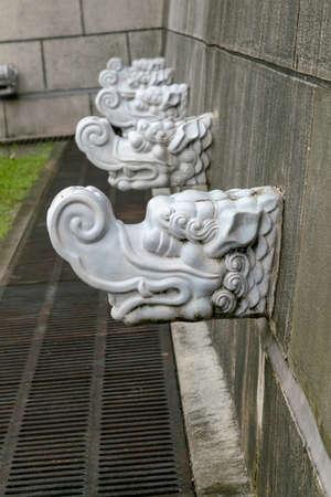 Vintage Dragon rock on wall, historic asia symbol