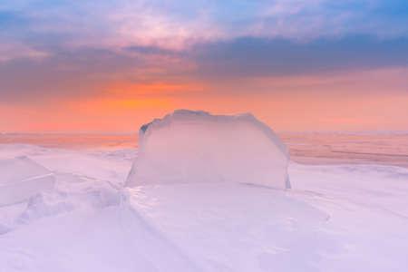 Beautiful frost ice water lake with sunlight skyline background, Baikal Russia winter season natural landscape
