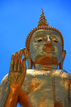 Gold buddha with blue sky Stock Photo - 9274199