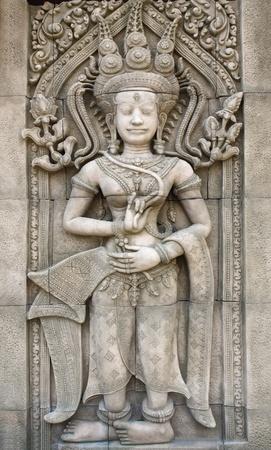 Apsara carvings on the wall of Angkor Wat Cambodia photo