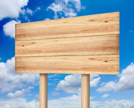 Wooden sign with blue sky photo
