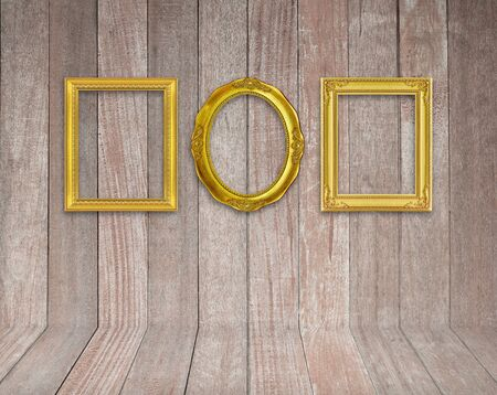 Old antique gold frame on wood texture background photo