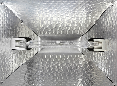 Light bulb on the aluminum  reflection Stock Photo