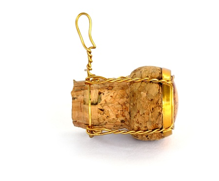 brown cork:  wine cork opened in celebration on a white background