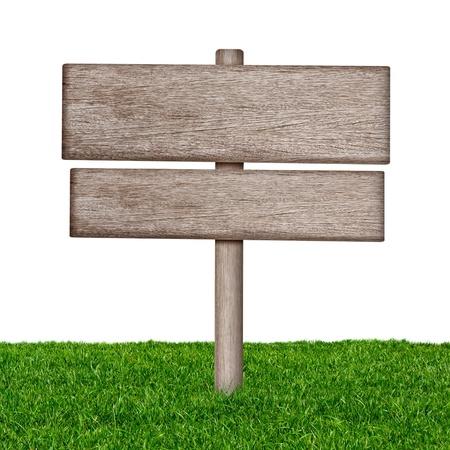 Holzschild mit grünem Gras auf einem weißen Hintergrund