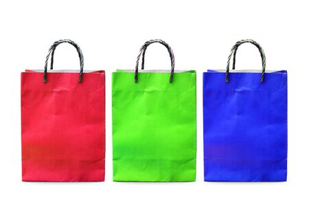 Colourful paper bag isolated on white background photo