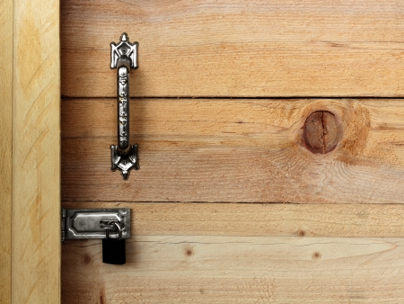 Locked wooden door with detail of wood texture photo