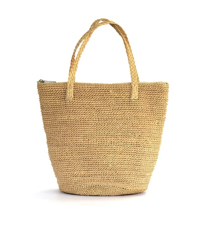 Straw bag on a white background photo