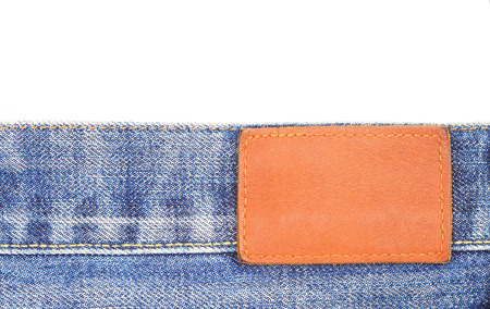 zigzagger: Blank jeans leather label on jean fabric Stock Photo
