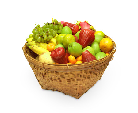 Woven basket full of different fruit. photo