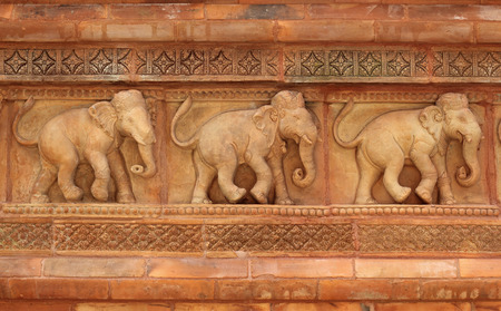 bass relief: Elephant sculptures on the wall of Thailand temple