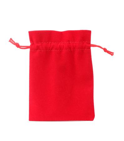 Red velvet bag isolated on white background photo