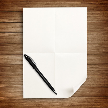 white paper with pen isolated on wood Stock Photo