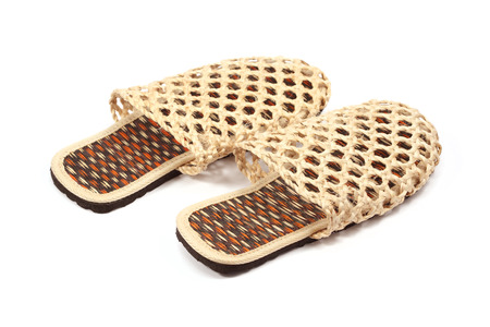 bast: Slippers woven from rattan on white background Stock Photo