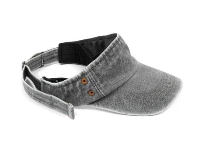 visor: Sun Visor gray jeans isolated on white Stock Photo